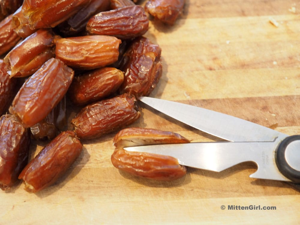 Cutting the dates with kitchen shears