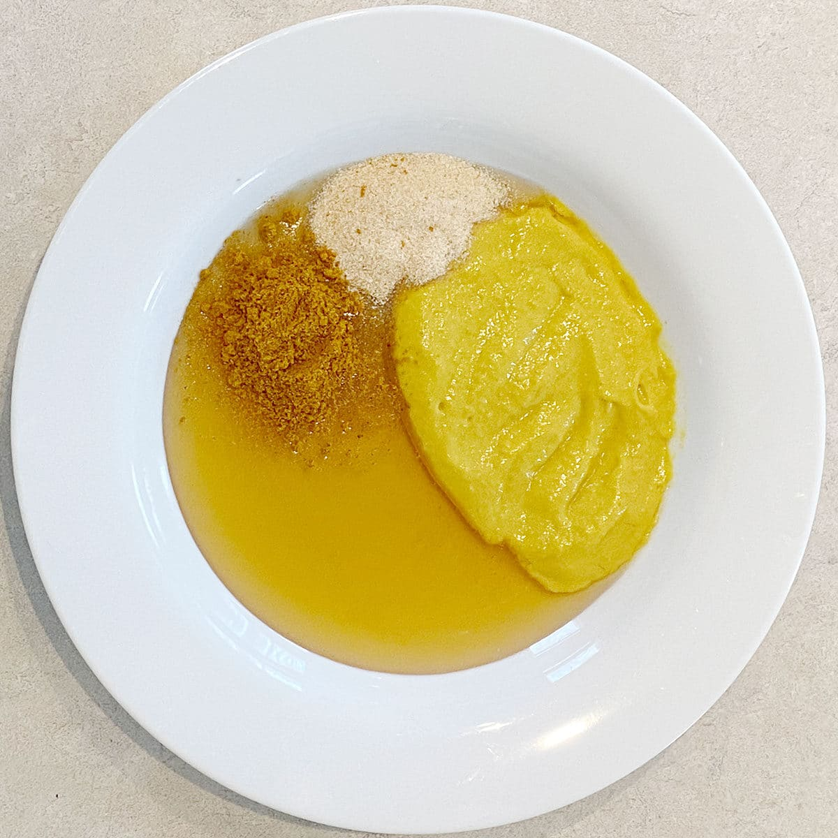 Spices, honey and mustard in a bowl