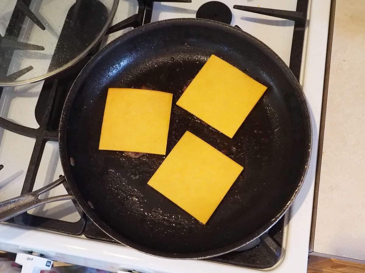 Slices of cheese on hamburger patties