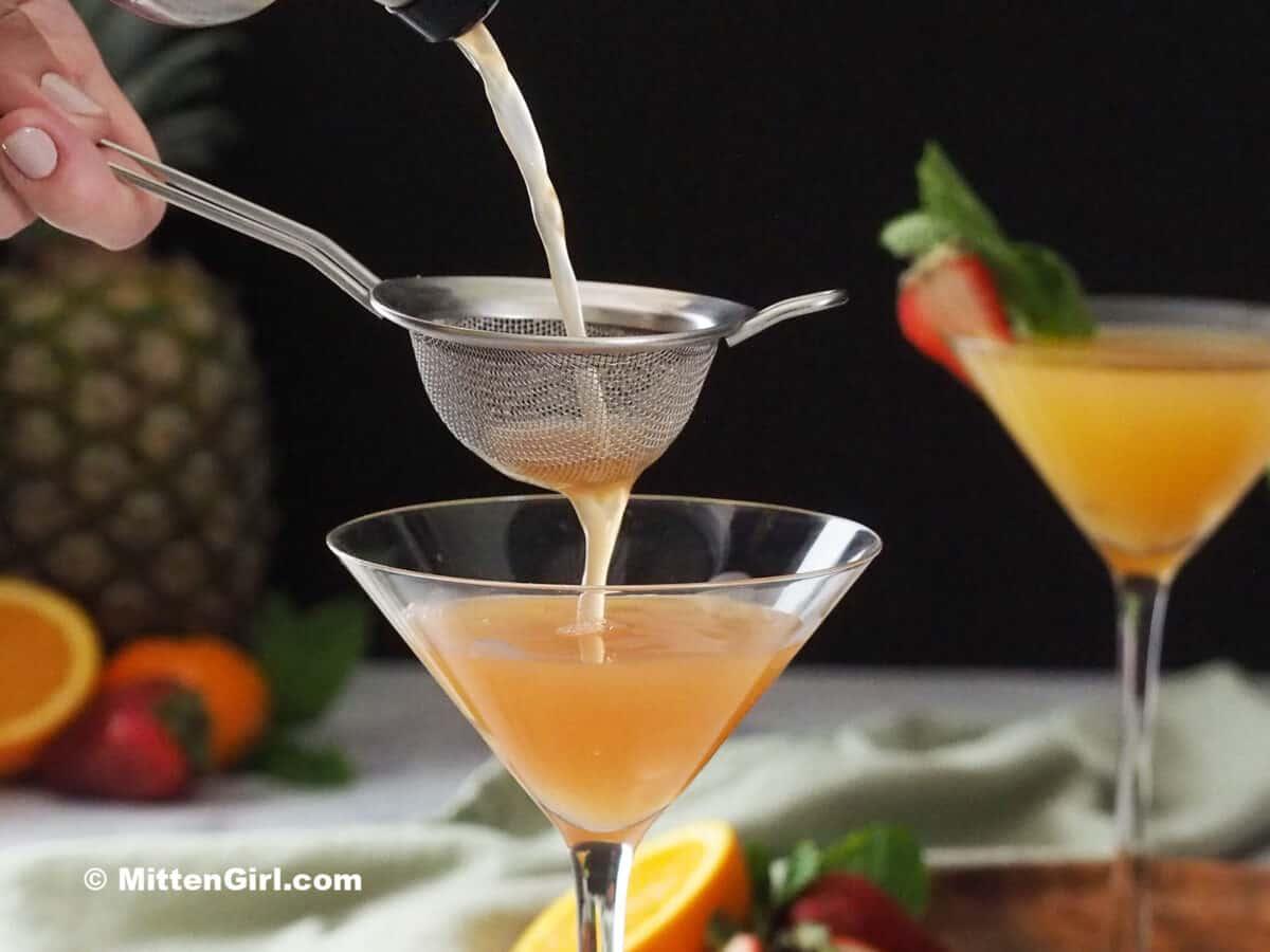 Pouring a Strawberry Pineapple Vanilla Vodka Martini