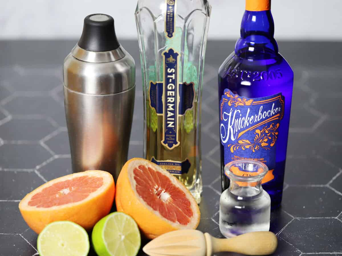 Ingredients and tools for grapefruit and elderflower cocktails
