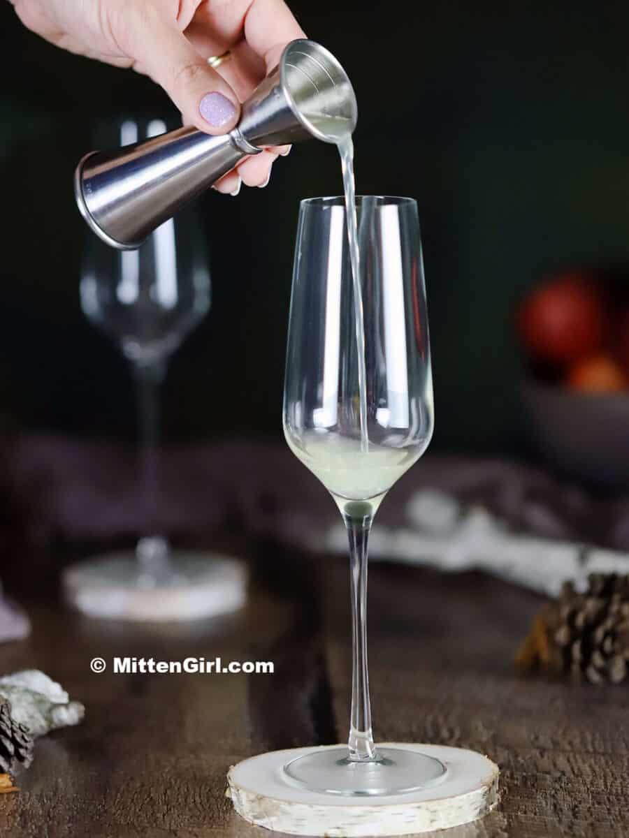 Pouring lemon juice into a champagne flute